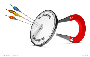 One target with many colorfull arrows hitting the center with a horseshoe magnet at the background. Concept image suitable for inbound marketing purpose or winning new customers illustration.